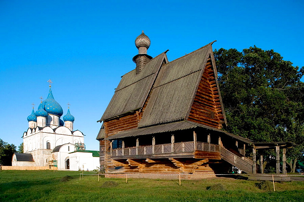 Cathedral of the Nativity (13th-16th century) and wooden Church of St, Nicolas from the village of Glotovo (1766) in the Kremlin, Suzdal, Golden Ring, Russia