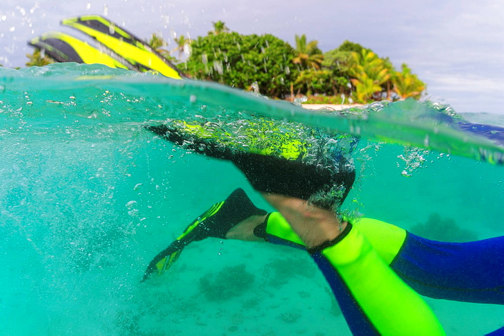 Close up of snorkelerís fins underwater