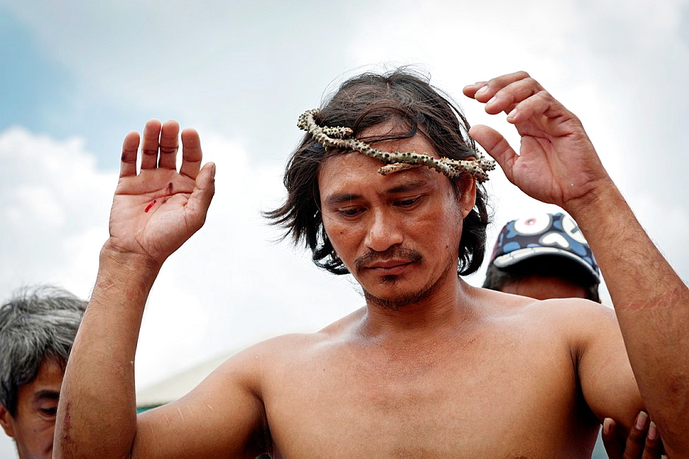 Rolly Bautista Pantoja showing his wounded hands after being crucified on Good Friday, San Fernando, Pampanga, Philippines