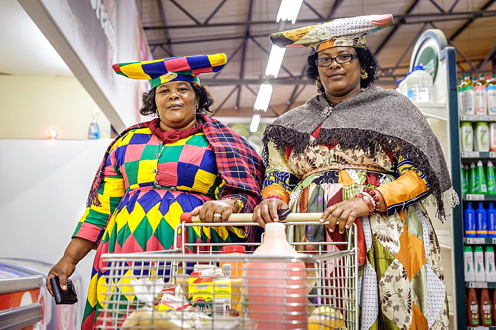 Herero women shopping, Opuwo, Namibia, Africa