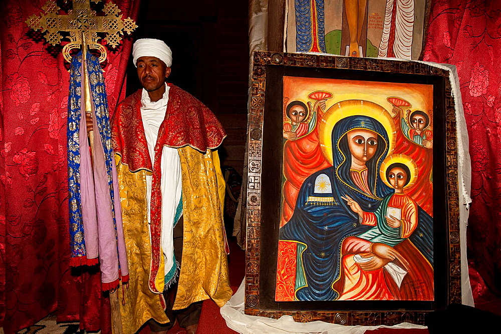 Priest and Colourful painting, Bet Emanuel Church, Lalibela, Ethiopia