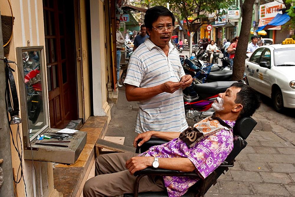 Street barber, Hanoi, Vietnam