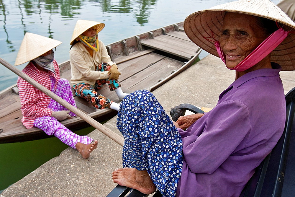 Boat Women Waiting For Passing Tourists, Hoi An, Vietnam