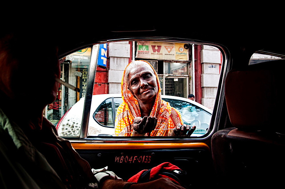 Woman begging in the streets of Calcutta West Bengal, India