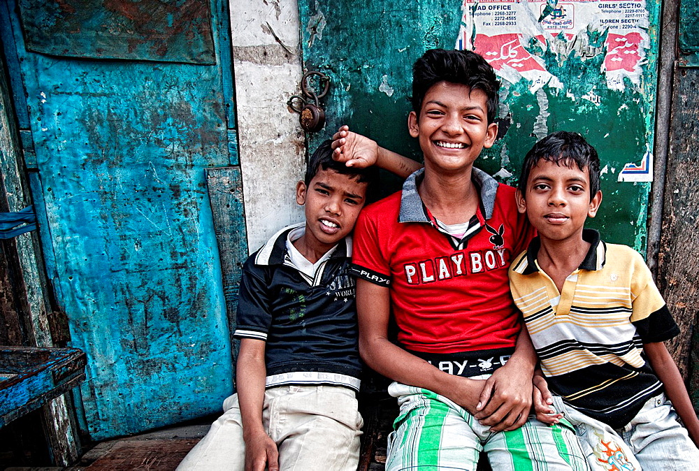 Children sitting in the streets of Calcutta West Bengal, India