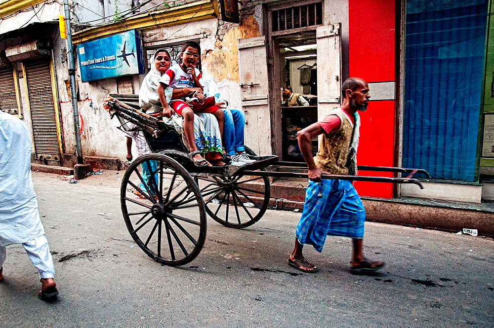 Rickshaws wallah working in the streets of Calcutta Calcutta, West Bengal, India