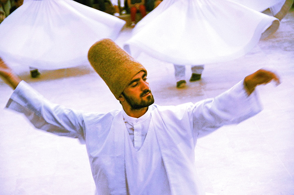Mystic dance performed within the Sama worship ceremony by the Sufi Dervishes, Konya, Anatolia, Turkey