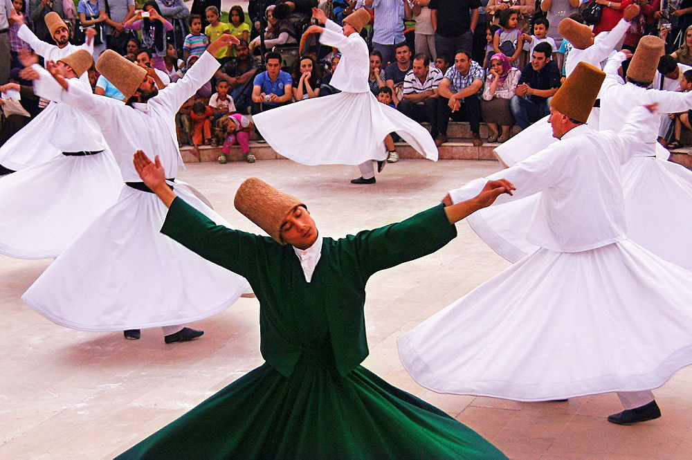 Mystic dance performed within the Sama worship ceremony by the Sufi Dervishes, Konya, Anatolia, Turkey - 817-435441