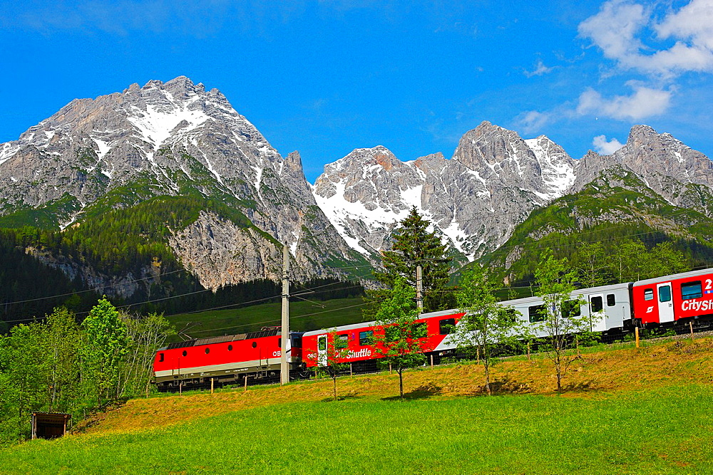 Passenger train on the Griesenpass in spring
