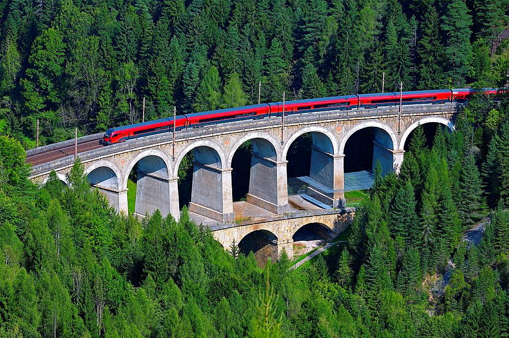 Passenger train on the Kalte Rinne Viaduct, UNESCO World Heritage Site, built 1848-1854