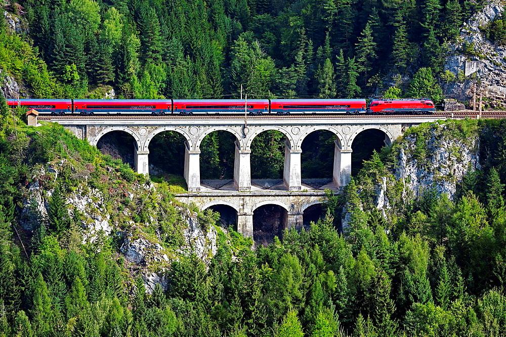 Passenger train on the Krausel-Klause Viaduct, UNESCO World Heritage Site, built 1848-1854