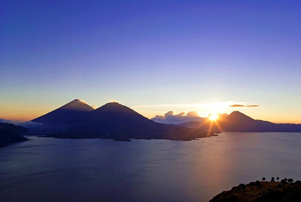 Sunset at Lake Atitlan with volcanoes Atitlan, Toliman and San Pedro in the background
