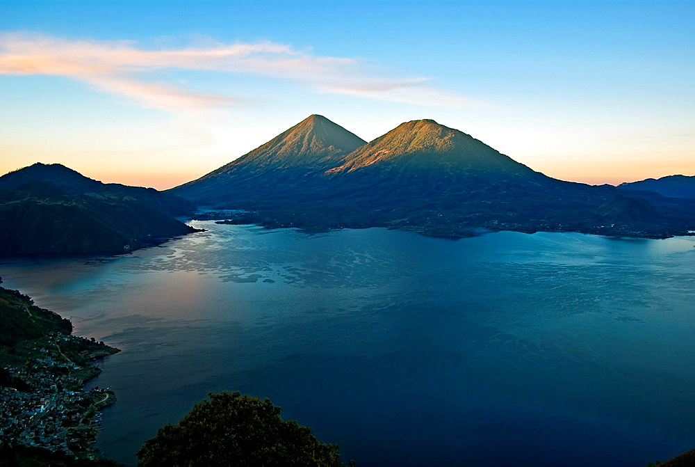 Sunrise at Lake Atitlan with volcanoes Atitlan and Toliman in the background