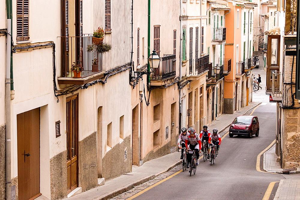 cyclists crossing the village of Bunyola, mallorca, Balearic Islands, Spain, Europe