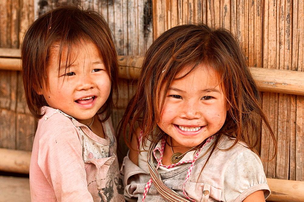 cute Lanten girls in their village, Luang Nam Tha, Laos