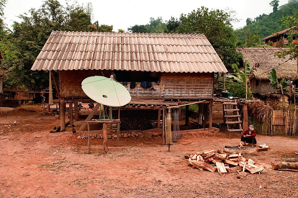 satellite dish in rural Khmu village, Luang Nam Tha, Laos