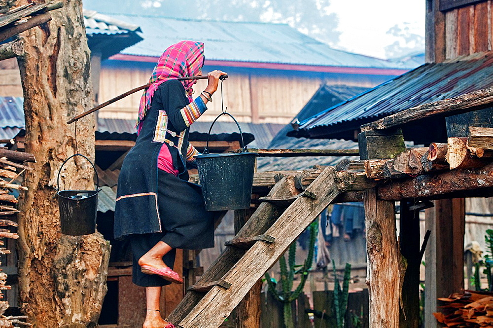 Akha woman carrying water, Phongsaly, Laos - 817-435955