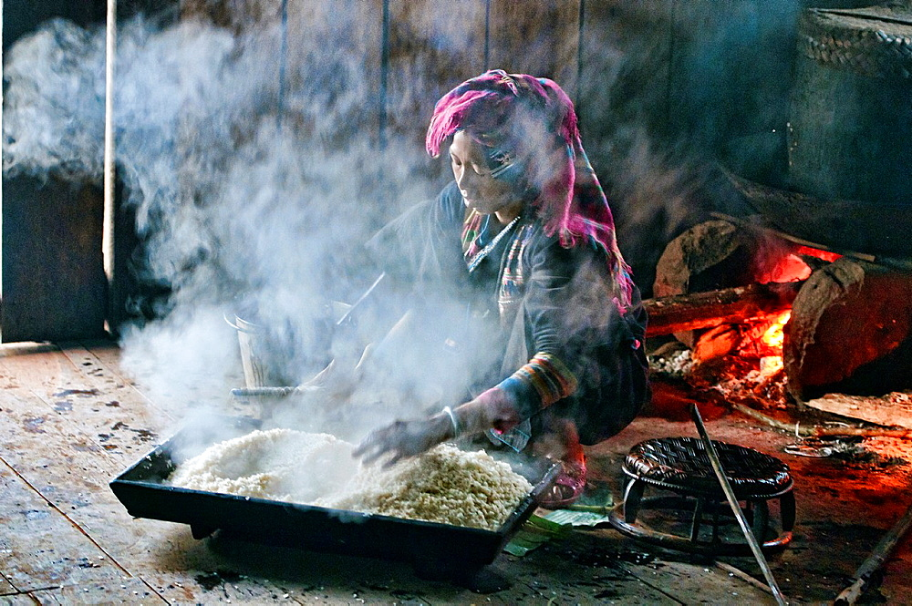 Akha woman preparing rice, Phongsaly, Laos