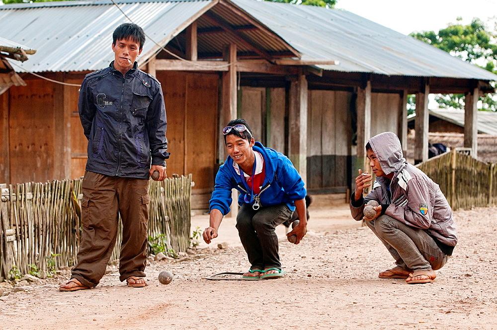 Akha boys playing petanque, Phongsaly, Laos