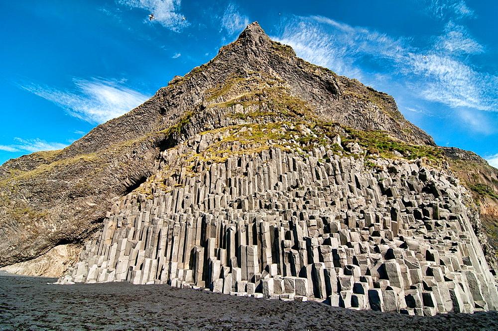 Studlaberg basalt columns on Reynisfjara black sand beach near Vik, southern Iceland