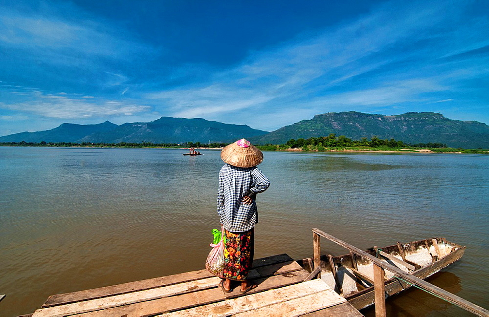 Waiting on the pier across from Wat Phu and Champasak on the Mekong River in Laos