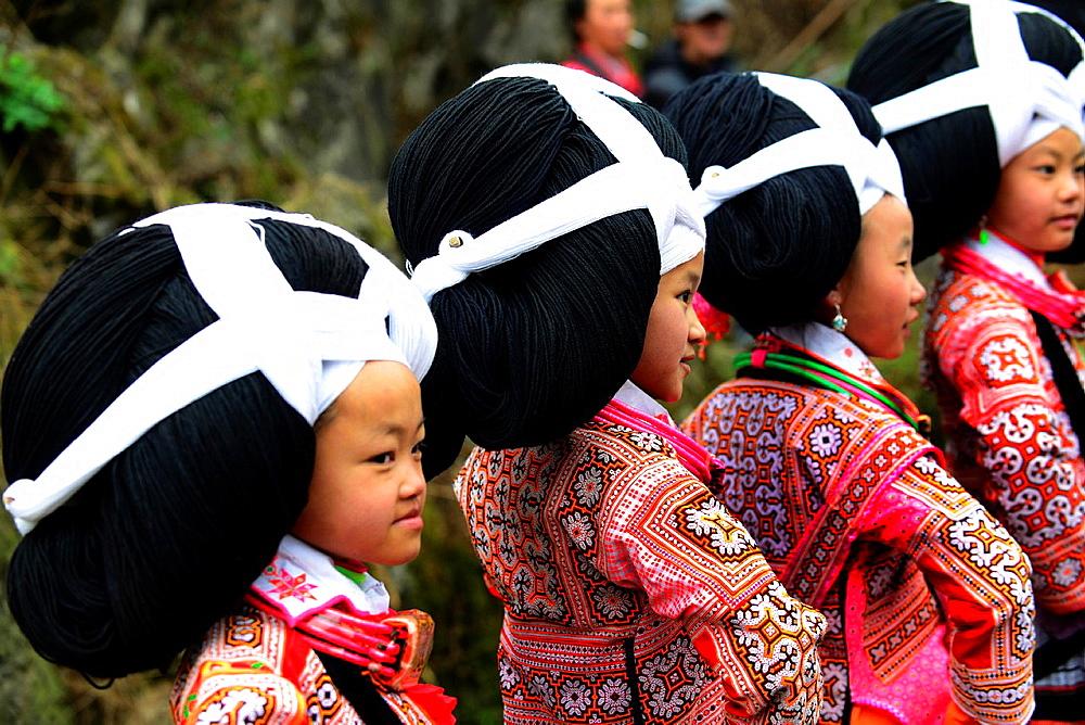 Long Horn Miao teenage girls dancing during the annual Tiao Hua festival in western Guizhou - 817-436183