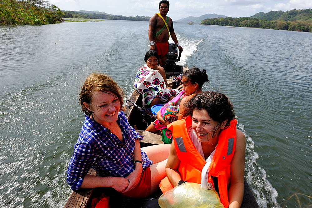 young tourist women going with pirogue toward a village of Embera native community living by the Chagres River within the Chagres National Park, Republic of Panama, Central America