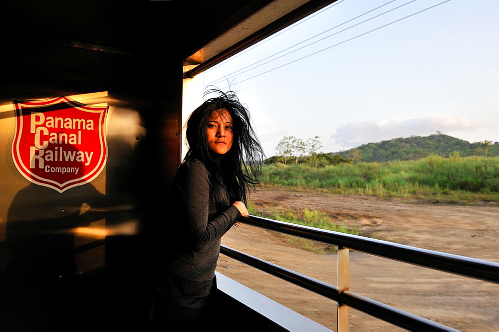 young woman on board of the Panama Canal Railway that links the Atlantic Ocean, Colon, to the Pacific Ocean, Panama City, Republic of Panama, Central America