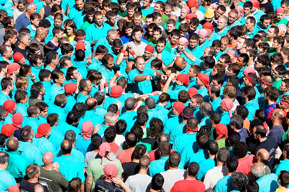 In the center man commanding the group 'Castellers' building human tower, a Catalan tradition Vilafranca del Penedes Barcelona province, Spain