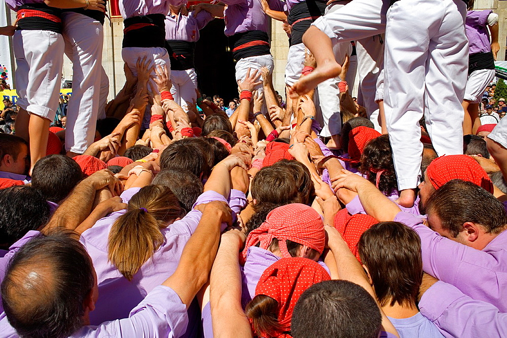 Colla Jove Xiquets de Tarragona 'Castellers' building human tower, a Catalan tradition Festa de Santa Tecla, city festival Placa de la Font Tarragona, Spain
