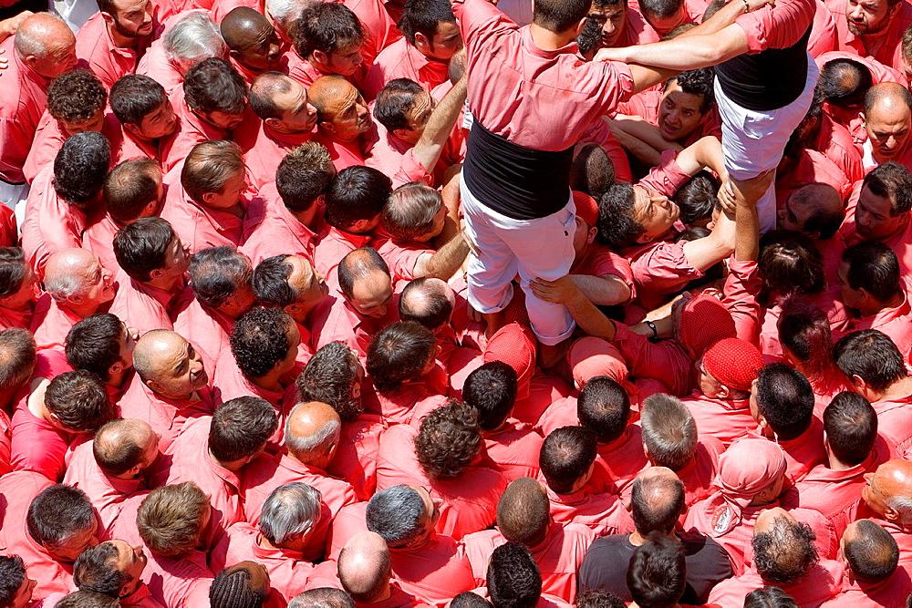 Colla Vella dels Xiquets de Valls 'Castellers' building human tower, a Catalan tradition Valls Tarragona province, Spain
