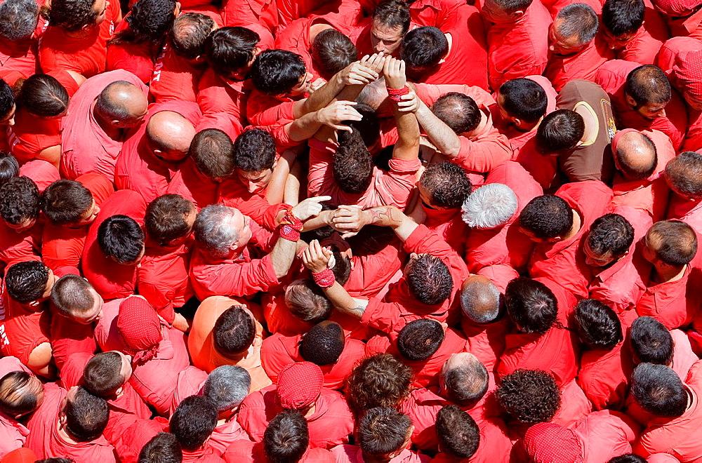 Colla Joves Xiquets de Valls 'Castellers' building human tower, a Catalan tradition Valls Tarragona province, Spain