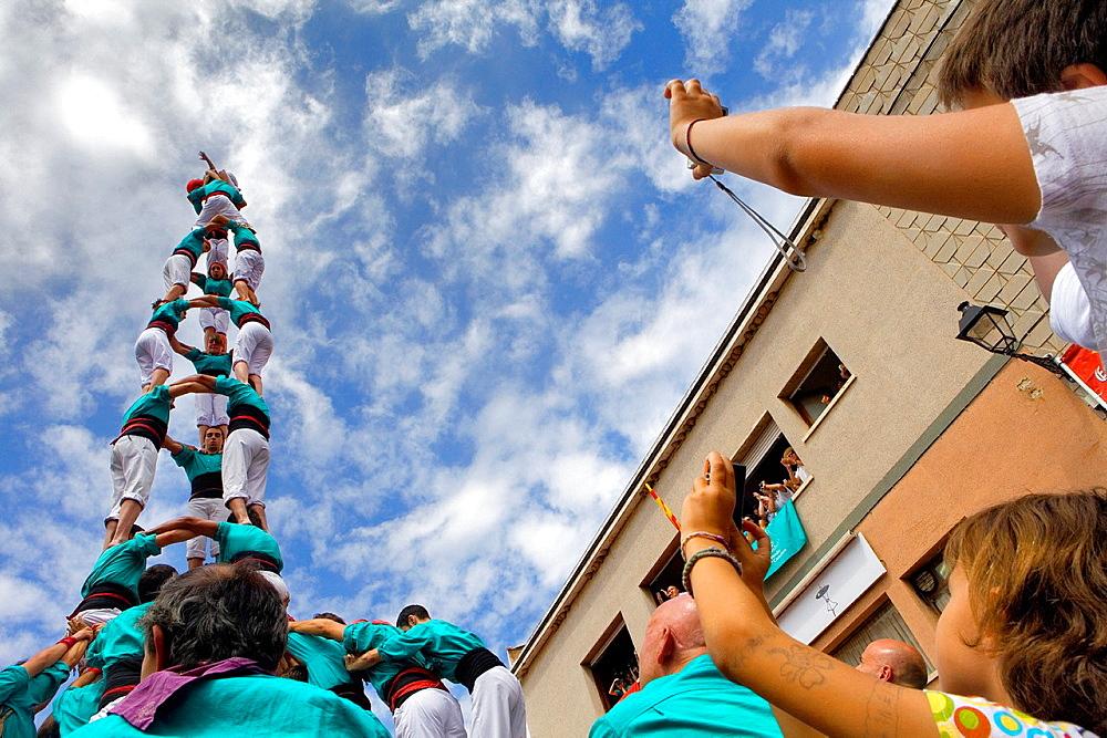 Castellers de Vilafranca 'Castellers' building human tower, a Catalan tradition Doctor Robert street La Bisbal del Penedes Tarragona province, Spain