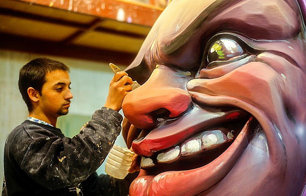 man making a falla in workshop of Manolo Martin,Ciudad del artista fallero Fallero city artist,Valencia,Spain