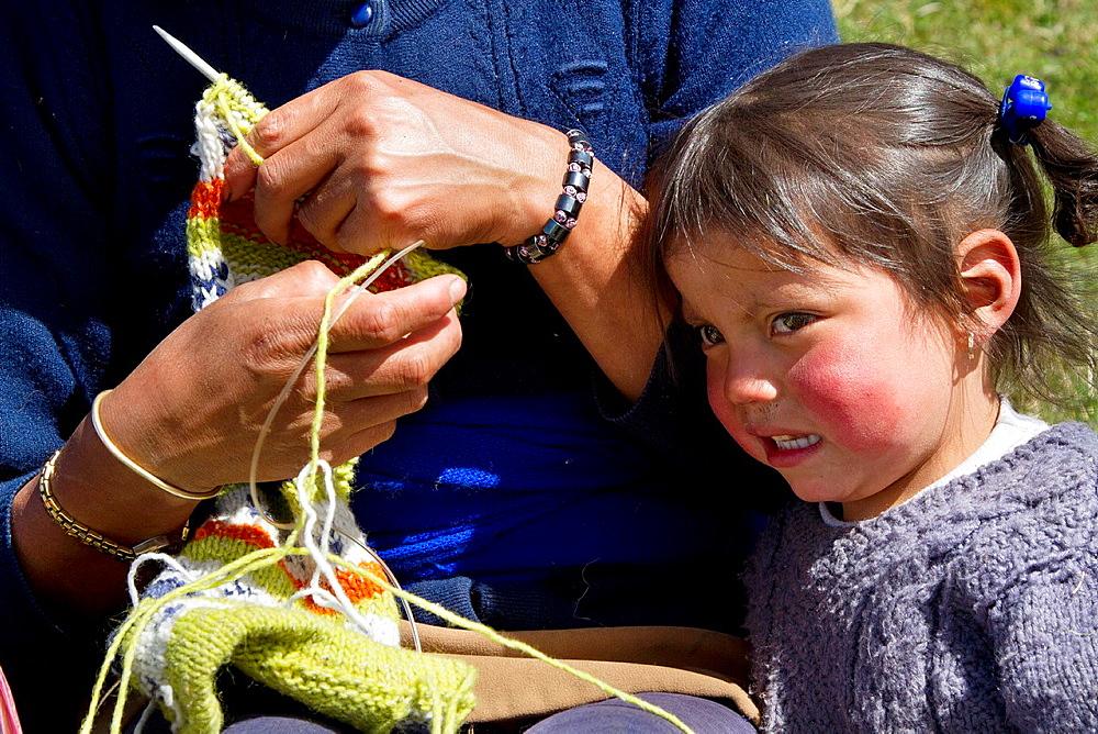 Ecuador, Salinas, 'paramo' upland, Verde Pampa community, woman knitting.
