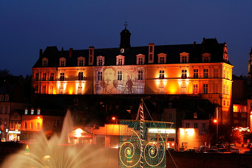 Laval city illuminated during the festivities of Christmas, the old courthouse with a projection of the portrait of the writer Alfred Jarry Mayenne, Pays de la Loire, France.