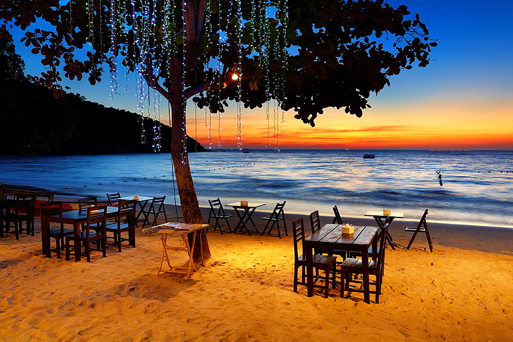 Beach Restaurant on the beach in Lima Coco Resort, sunset on the Ko Samet Island, Thailand