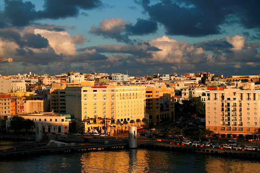 The rising sun casts long shadows as dawn breaks in the Caribbean port city of San Juan, Puerto Rico
