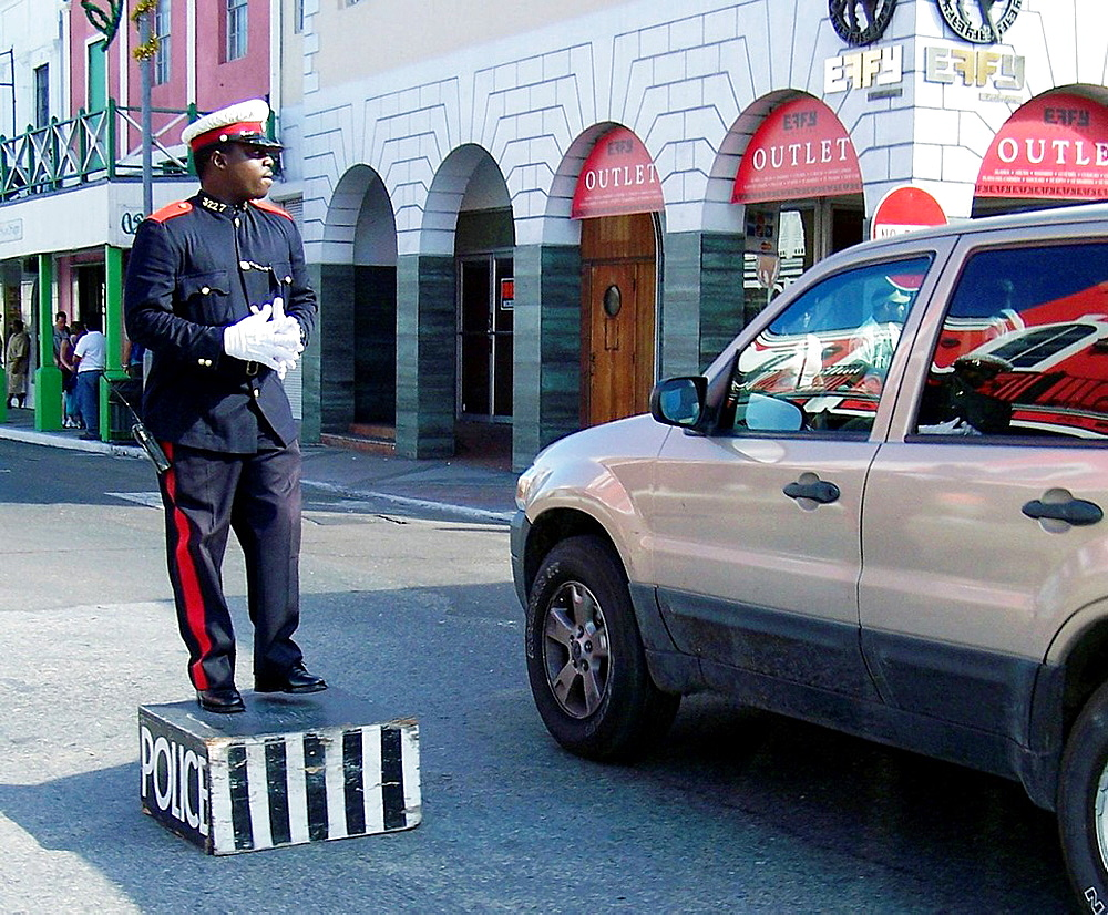 A traffic cop at work on the Caribbean island of Nassau, Bahamas
