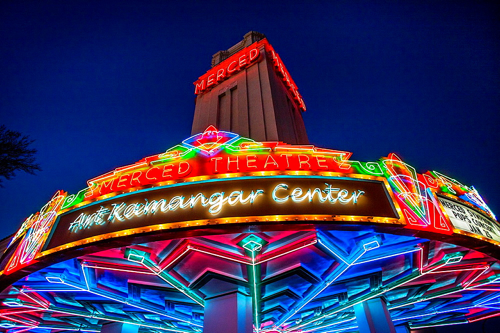 Opened in 1931, the Merced Theater in Merced, CA, is an example of Spanish Colonial Revival architecture. Note elaborate neon decoration.