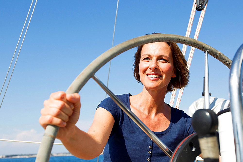 Smiling woman driving boat