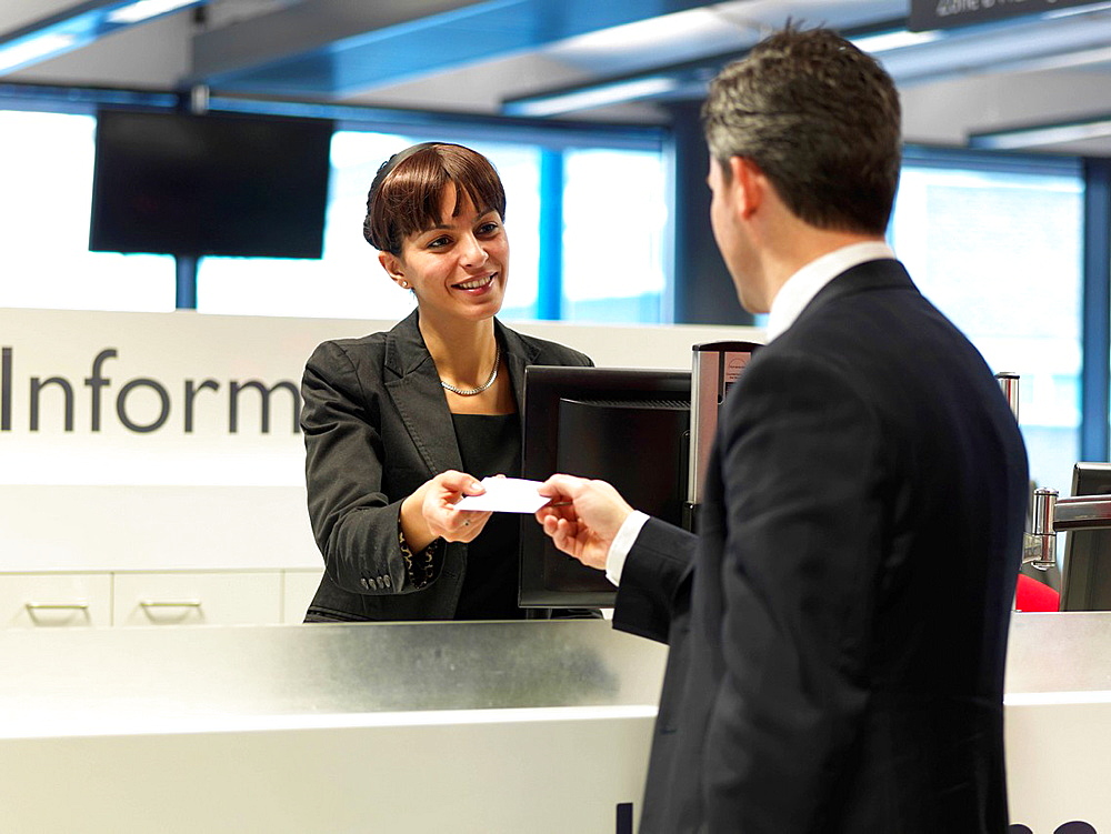 Receptionist talking to businessman