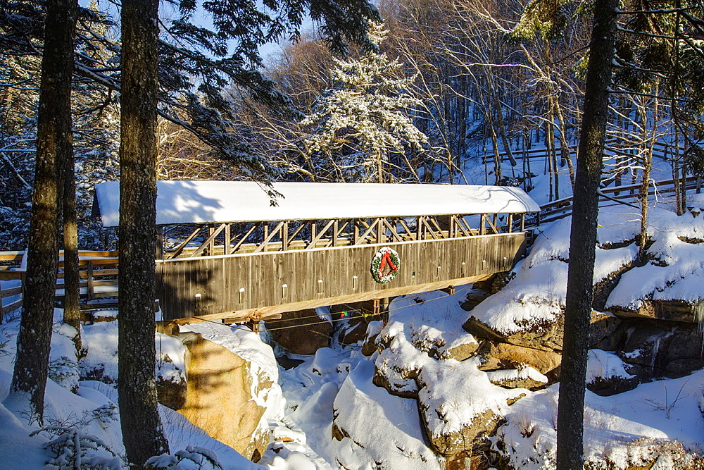 Franconia Notch State Park, Sentinel Pine Covered Bridge during the winter months. It is a footbridge which crosses over the Pemigewasset River in Lincoln, New Hampshire, USA.
