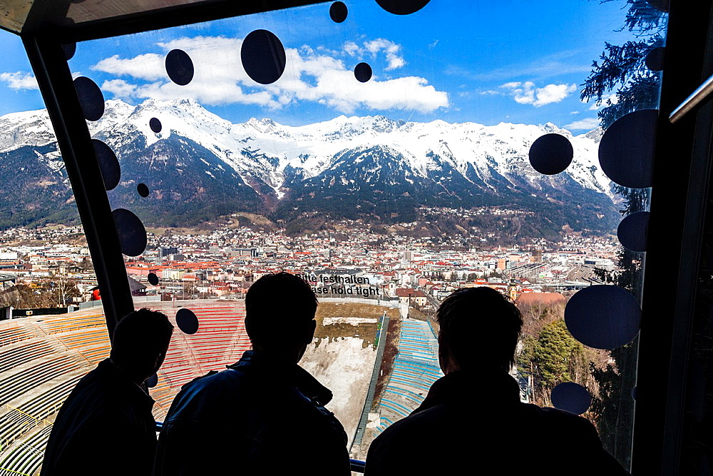 View from Bergisel Schanze ski-jump down onto the stadium, city of Innsbruck and Nordette mountain. Tyrol, Austria, Europe.
