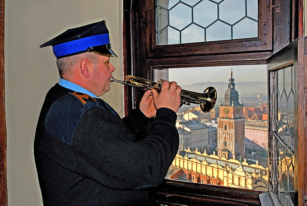 On every hour, a trumpet signalócalled the Hejnal mariackióis played from the top of the taller tower of St. Mary's Basilica, Krakow, Poland, Central Europe