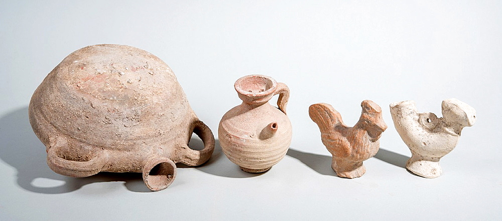 Terracotta utensils Roman period 1-2 century CE pilgrims flask, Juglet and roosters figurines.
