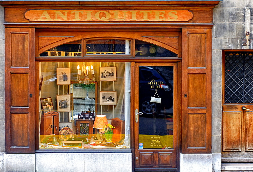 window of old fashioned antique shop, old town of Geneva, Switzerland