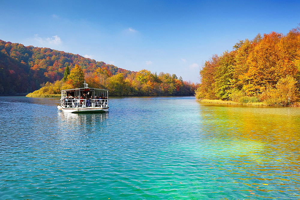 Croatia, autumn landscape of Plitvice Lakes National Park, electric power ferry boat on the lake, Plitvice, central Croatia.