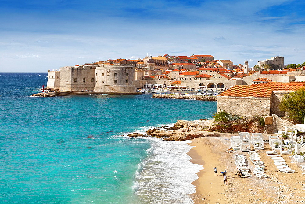 Croatia, Dubrovnik beach and Old Town harbor, Dalmatia, Croatia.
