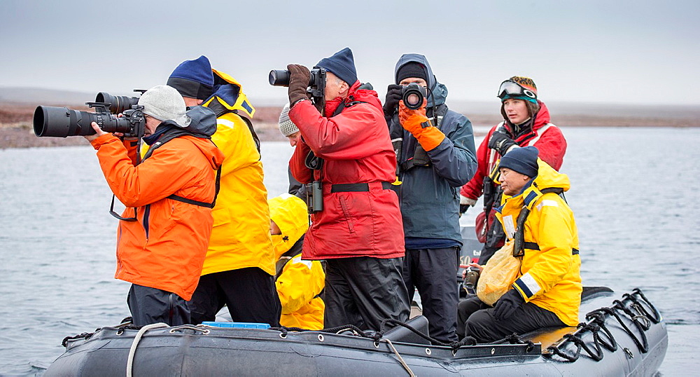 Tourist in Zodiacs watching and photographing polar bears, Svalbard, Norway.